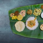 Celebrated every year around the months of August-September, Onam is the harvesting festival of the Indian state Kerala. Onam Sadhya is a traditional meal covering tens of dishes which is usually served on banana leaves. We bring a complete guide for preparing your own Onam Sadhya meal.