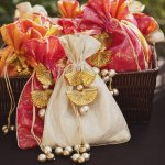 """Chances are you won't be able to greet all your guests upon their arrival, so a wedding welcome bag of goodies is a great way to say, """"Hello, we're glad you're here!"""" right away. Check out our breakdown of everything you need to assemble the perfect goody bag that's sure to make your guests feel right at home."""