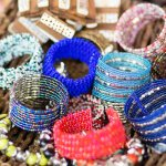 Hal-hal yang berbau Bali selalu menarik perhatian. Termasuk ragam aksesori seperti gelang. Dengan beragam model dan material, gelang-gelang khas Bali bisa menjadi aksesori yang bisa disesuaikan dengan busana yang dikenakan. Mau penampilan bergaya feminin, kasual, atau eksotik, kamu bisa mewujudkannya dengan memakai gelang khas Bali.