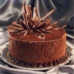 The article talks of ways of decorating a cake with chocolate. We have provided you with ways of making different kinds of chocolate decorations for your cake, that you can use the next time you bake a cake for a loved one.