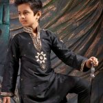 If your kid is a boy, and you are attending a traditional function such a marriage occasion, the kid's kurta pyjama has no competitors. It creates an aura of ethnicity. Since these garments will never lose their appeal, it will always be a safe bet to go with them. So here are elegant kurta designs that will be perfect for your handsome little man.
