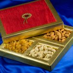 Nuts and dry fruit, along with traditional Indian sweets, have been the favoured gifts for Diwali since ages. With new kinds of gift items gaining ground, they may not be as popular as they once were, but you know Diwali isn't Diwali till you have received at least a few boxes of dry fruit. This nutritious gift is perfect for the approaching winter so pick up old traditions and give a dry fruits gift pack to your relatives. Here you can choose from the best and fastest selling dry fruits gift packs and Diwali dry fruit gift boxes in 2018.
