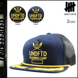 アンディフィーテッド アンディフィーテッド UNDEFEATED キャップ スナップバックキャップ メッシュキャップ 2カラー TRAINING CAMP TRUCKER CAP メンズ